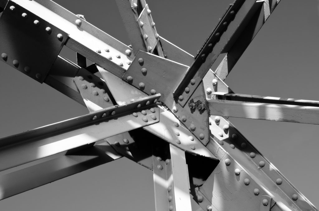 Geometric photograph of a steel bridge by Mark D. Whitney